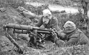 A British Vickers machine gun unit, wearing gas masks, the Battle of the Somme, 1916